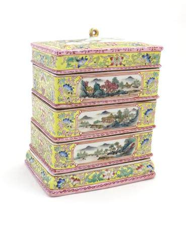 A Chinese famille jaune food container of rectangular form with five tiers with scrolling floral and