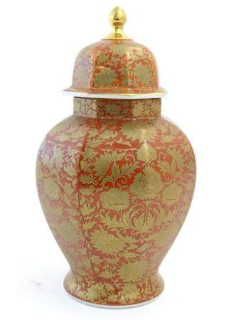 An Oriental vase and cover of octagonal baluster vase with floral and foliate gilt detail. Marked