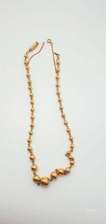 Collier dit marseillais en or jaune 18k (750 millièmes) formé de boules disposées en chute, fer