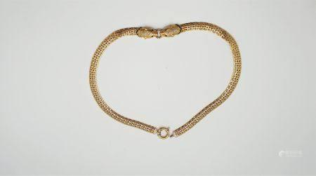 Collier en or jaune et or blanc 18k (750millièmes), le décolleté orné de deux têtes de panthère