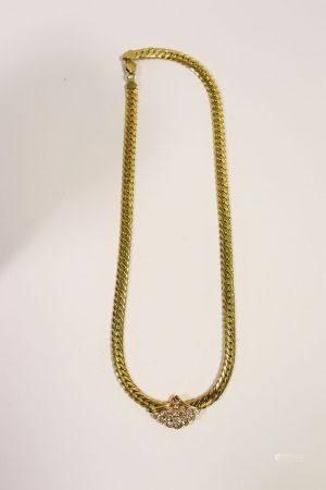 Collier ras de cou en or jaune 18k (750 millièmes), le décolleté orné d'un clip amovible en for