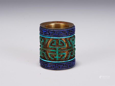 A CHINESE GILT BRONZE THUMB RING WITH GEMS INLAIDED