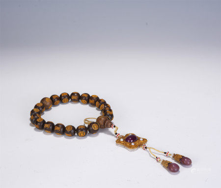 A CHINESE CARVED AGARWOOD PRAYER BEADS