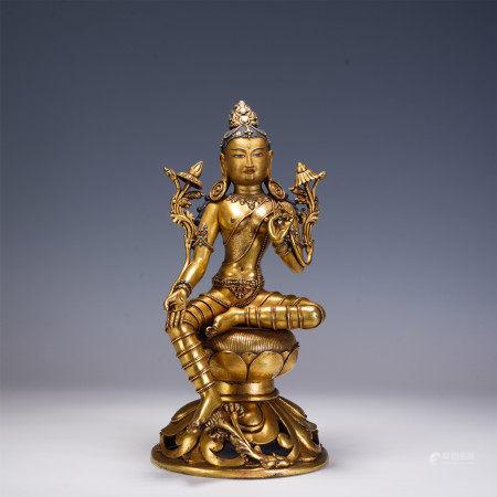 A NEPALESE TYPE GILT BRONZE FIGURE OF BUDDHA