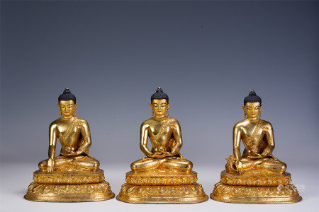 A GROUP OF THREE CHINESE GILT BRONZE FIGURE OF BUDDHAS