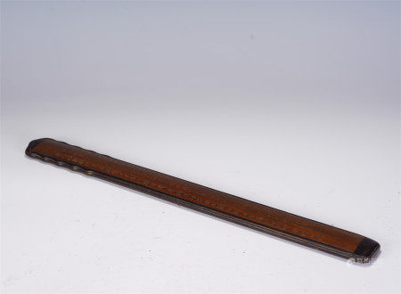 A CHINESE CARVED BAMBOO FERULE
