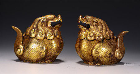 A PAIR OF CHINESE GILT BRONZE FOO-DOG INCENSE CAGE