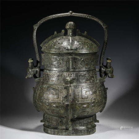 A CHINESE BRONZE LONG HANDLE CENSER