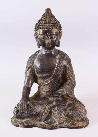 A GOOD CHINESE BRONZE FIGURE OF SEATED BUDDHA, the body with raised decoration of dragons and stylized funghi