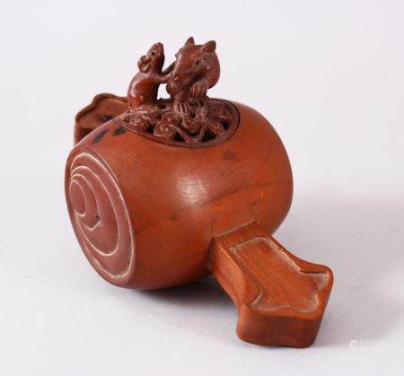 A JAPANESE CARVED WOODEN CARVED KORO, carved in the form of daikoku mallet, with a pierced cover with a finial