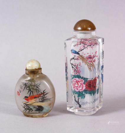TWO CHINESE REVERSE PAINTED SNUFF BOTTLES, One with floral scenes, the other with birds, 9cm & 5cm.