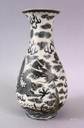 A CHINESE PORCELAIN DRAGON VASE, the dragon amongst stylized clouds and waves, the base with a four character