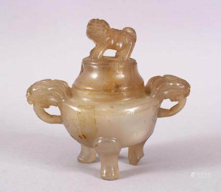 A CHINESE 19TH CENTURY CARVED JADE OR HARDSTONE CENSER & COVER, with twin carved beast handles, upon three fee
