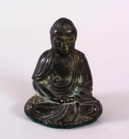 A CHINESE BRONZE FIGURE OF SEATED BUDDHA, seated with hands and legs crossed, the verso with a raised our char