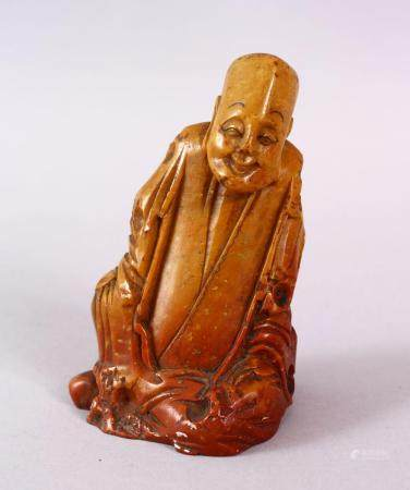 A CHINESE CARVE3D SOAPSTONE FIGURE OF A JOLLY MAN, in seated position, 11cm