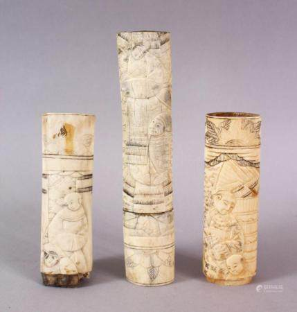 THREE 19TH CENTURY CHINESE CARVED IVORY SWORD / KNIFE HANDLES, each carved with various figures, 16cm, and two