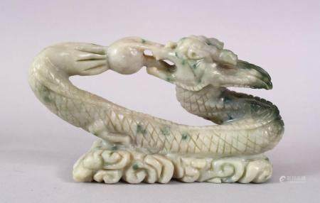 A CHINESE CARVED SOAPSTONE FIGURE OF A DRAGON & PEARL, the dragon intertwined chasing the pearl amongst waves,