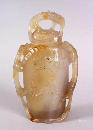 A CHINESE CARVED AGATE LIDDED CENSER / VASE, with relief carved detailing of chilong to the sides and cover, 1