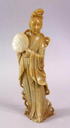 A CHINESE CARVED SOAPSTONE FIGURE OF GUANYIN, stood holding a fan 24cm high.