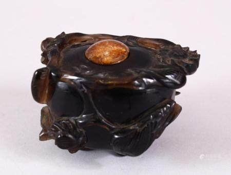 A CHINESE CARVED DARK CRYSTAL / QUARTZ FLORAL POT & COVER, the body carved with flora and stood upon tripod fe