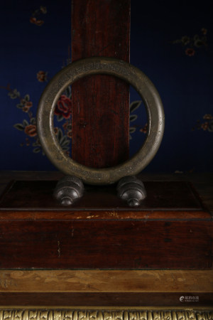 A BRONZE RING SHAPE PAPERWEIGHT.'CHANG CHUN YUAN' MARK. QING DYNASTY.