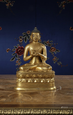 A RARE AND FINELY-CAST GILT-BRONZE FIGURE OF BUDDHA. MONGOLIA. QING DYNASTY.