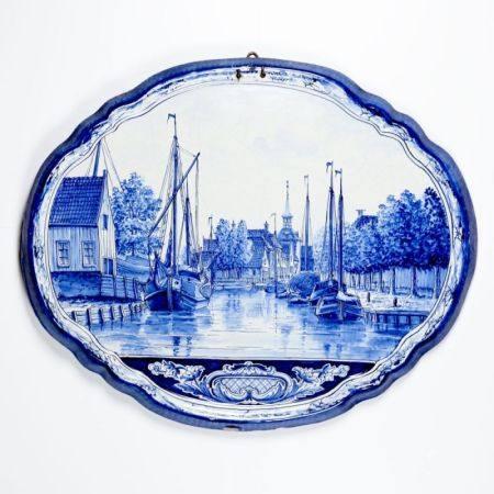 Querovale Wandplatte Holland, 19. Jahrhundert. Fayence, heller Scherben. Blau bemalt, glasier