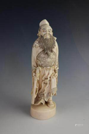A Japanese carved ivory okimono of Shoki The Demon Queller, Meiji period (1868-1912), modelled