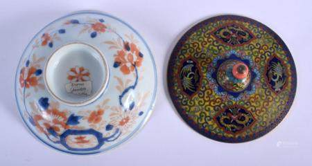 A 19TH CENTURY CHINESE CLOISONNE ENAMEL AND CORAL CENSER COVER together with a Yongzheng/Qianlong imari cover. Largest 13 cm wide. (2)