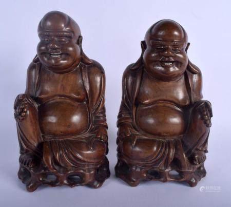 A PAIR OF 19TH CENTURY CHINESE CARVED HARDWOOD FIGURE OF BUDDHAS modelled upon openwork bases. 24 cm x 9 cm.