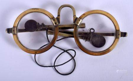 A RARE PAIR OF EARLY 20TH CENTURY CHINESE CARVED BUFFALO HORN SPECTACLES with folding arms. 14 cm wide.