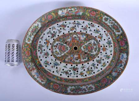 A LARGE 19TH CENTURY CHINESE CANTON FAMILLE ROSE PORCELAIN STRAINING DISH AND COVER Qing, painted with flowers, birds and trailing vines. 40 cm x 37 cm.