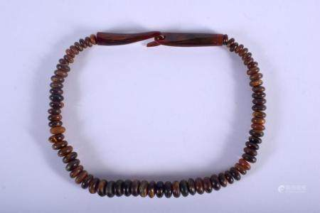 AN EARLY 20TH CENTURY CHINESE CARVED HORN BEADED NECKLACE possibly Buffalo, of graduated form. 44 grams. 42 cm long.