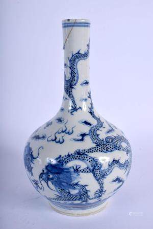 A 19TH CENTURY CHINESE BLUE AND WHITE PORCELAIN DRAGON VASE bearing Kangxi marks to base, painted with dragons. 20 cm high.