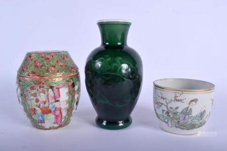 A 19TH CENTURY CHINESE CANTON FAMILLE ROSE JAR AND COVER together with a jar & a vase. Largest 16 cm high. (3)