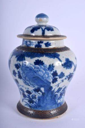 A 19TH CENTURY CHINESE BLUE AND WHITE CRACKLE GLAZED VASE AND COVER Qing, painted with flowers. 21 cm x 11 cm.