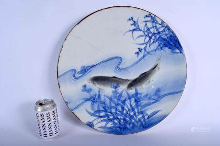 A LARGE 19TH CENTURY JAPANESE MEIJI PERIOD BLUE AND WHITE PORCELAIN CHARGER painted with two carp. 30 cm diameter.