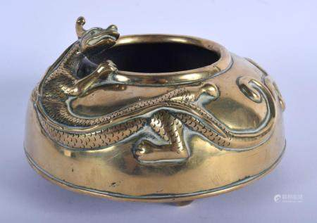 A LARGE 19TH CENTURY CHINESE BRONZE DRAGON CENSER Qing, overlaid with a roaming chilong dragon. 1197 grams. 15 cm wide, internal diameter 7 cm.