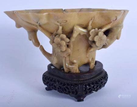 A LATE 18TH/19TH CENTURY CHINESE CARVED SOAPSTONE LIBATION CUP Ming style, overlaid with foliage. 19 cm x 9 cm.