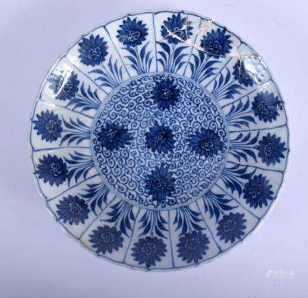A LATE 17TH CENTURY CHINESE BLUE AND WHITE SCALLOPED DISH Kangxi, bearing Chenghua marks to base, painted with floral sprays. 20.5 cm wide. Provenance: Sotheby's 29th April 1999.