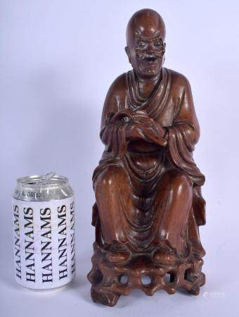 A 19TH CENTURY CHINESE CARVED HARDWOOD FIGURE OF A BUDDHA Qing, modelled upon an openwork base. 30 cm x 12 cm.