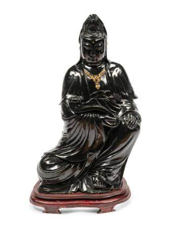 A Chinese Export Carved Jade Figure of Guanyin