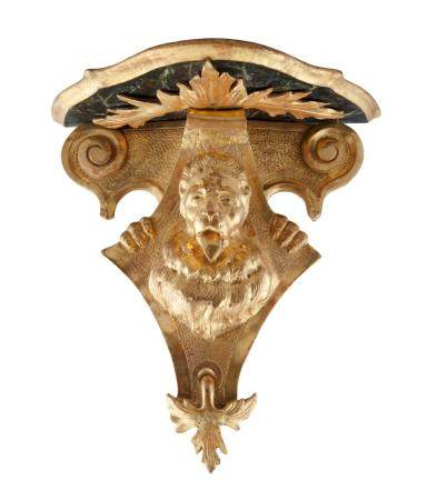 A PAIR OF 19TH CENTURY GILTWOOD WALL BRACKETS, each with shaped top over scroll supports and lion he