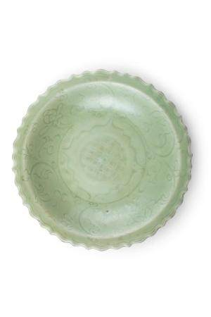 A CHINESE LONGQUAN CELADON DISH, 14th century, of shallow circular form, with flattened barbed rim,