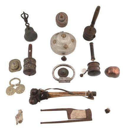 A COLLECTION OF 18TH/19TH CENTURY TIBETAN RITUAL ITEMS, comprising: - a human thigh bone trumpet wit