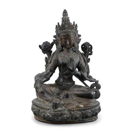A CHINESE BRONZE FIGURE OF A SEATED GUANYIN, Qing Dynasty, in meditative pose, with raised left hand