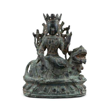 ***PLEASE NOTE PERIOD SHOULD READ QING DYNASTY*** A CHINESE BRONZE GROUP OF A BUDDHIST DEITY, Qing D