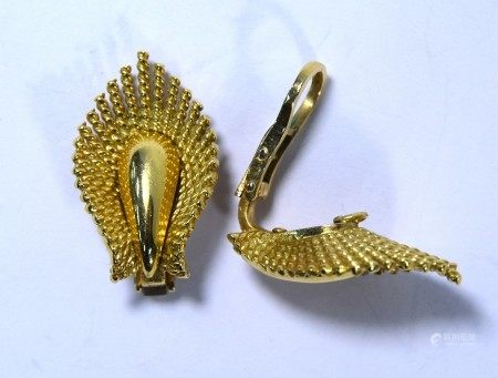 A pair of 18ct yellow gold earrings in the form of a stylised leaf