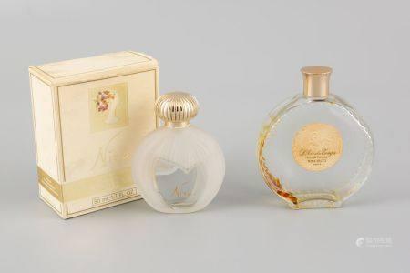 LALIQUE France. Deux flacons de parfum Nina Ricci L'air du temps en verre et verre moulé pressé