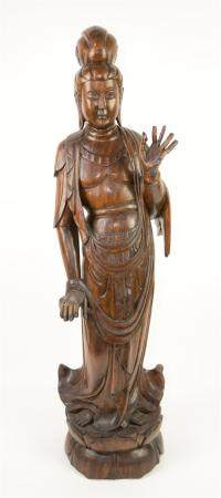Chinese carved hardwood figure of Guanyin, on integral lotus base, 91cm high,